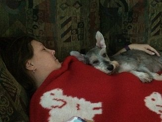 Riley snuggled up with his mom